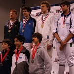 On the medals stand for Division II Men's Epee. Julian Raul (back row, far right) takes bronze, a day after winning silver in Division III Men's Epee.  Photo courtesy of DC Fencers Club.