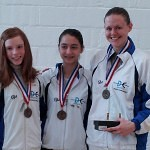 DCFC Medalists in Senior Women's Epee at the Cherry Blossom Open.  From L-R:  Juliana Bain (8th place), Amanda Sirico (bronze), and Gold Medalist Rebecca Chimahusky