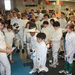 At left, Fences with Wolves tournament organizer Jacob Asher greets more than 70 youth fencers to DC Fencers Club