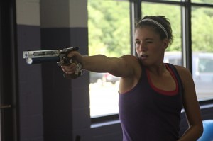 Suzanne practices pistol shooting, one of the events in Modern Pentathlon