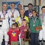DCFC member Kashi Way (far left) won gold in both epee and foil at the 2012 Tom Wright Vet Tourney, but his children get the prizes.  Pictured here with the other medalists for the foil event.